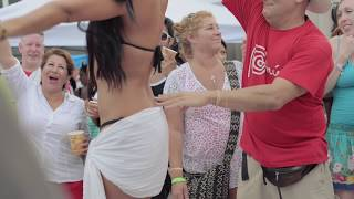 Guy grabs and touches bikini contestants all over