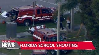 At least 17 dead in Florida school shooting; suspect in custody