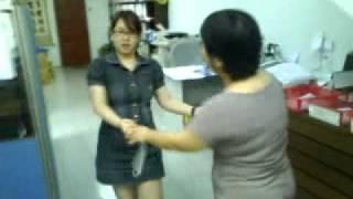 two office girls making fun
