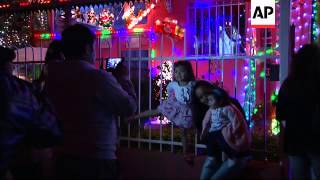 Christmas lights on houses become increasingly popular; Grand Santiago Tower lit up