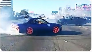 Cars Doing Donuts On Highway Causes Traffic Jam