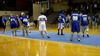boy cheerleaders do routines.