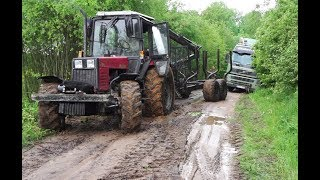 Belarus  Mtz 892 forestry tractor saves Volvo timber truck, slippery road