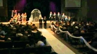 Bride shocks groom as she sings to him walking down the aisle.