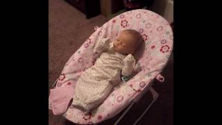 Changing sophia in her bounser