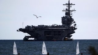 Onboard an aircraft carrier before it goes to fight ISIS