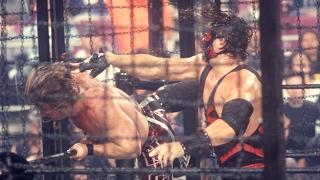 Kane throws Chris Jericho through glass in the Elimination Chamber: Survivior Series 2002