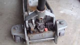 How to repair a floor jack that leaks fluid