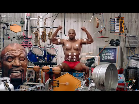 Terry Crews playing all the instruments by using his muscles