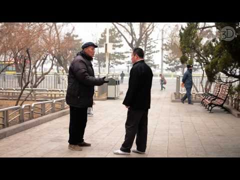 Old man teaching Kung Fu in a park near Tiananmen Square