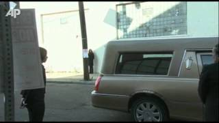 Houston's Casket Arrives at Church for Funeral