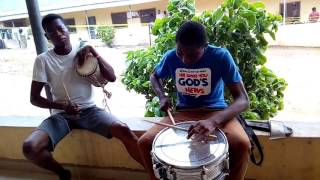Unilorin students playing the talking drum and snare