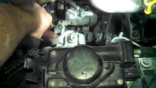 2001 Suzuki Grand Vitara XL 7 2.7L Air conditioning compressor removal and smaller belt installed