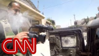 Cameraman narrowly survives sniper shot