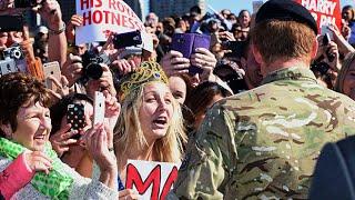 Prince Harry stuns fan holding