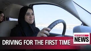 Women in Saudi Arabia finally hit the road as driving ban lifted