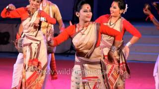 Assamese women present signature Bihu dance