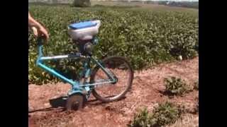 Manual seeding with a bike planter