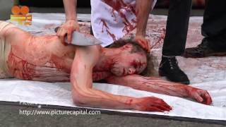 PETA protest - Meat is Murder man fake slaughter at Marble Arch