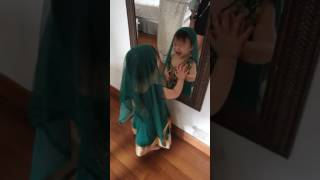 Penny tries on a sari and her reaction is so cute.
