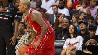 Rihanna Caught Eyeing & Attending Chris Brown