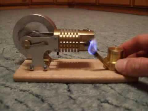 meu prototipo de motor para gerar eletricidade de fornos a lenha em para zonas rurais