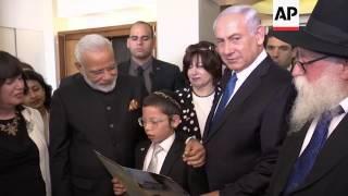 Modi meets boy whose parents were killed in Mumbai