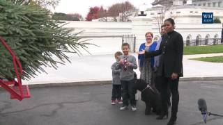 First Lady Michelle Obama Welcomes the Official White House Christmas Tree to the White House