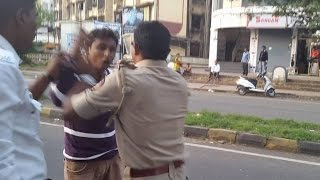 Traffic Police caught assaulting young man in public