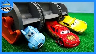Disney cars toys, Lightning McQueen run away. Angry Frank is following.