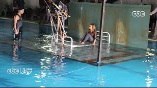 شاهد كواليس تصوير مشهد غرق نيللي كريم في مسلسل سقوط حر