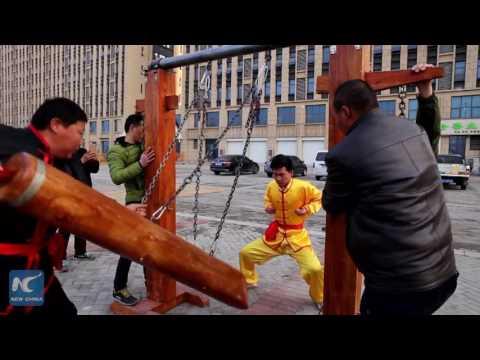 Ball-breaking stamina Iron Crotch Kung Fu  master shows skills