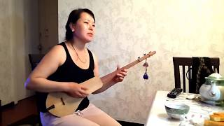 Singing Kyrgyz Woman Entertains with National Instrument the Komuz
