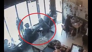 Shocking moment thief strolls into cafe and grabs woman