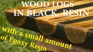 EPOXY table top: Black resin and Crystal clear resin and wood logs: DIY