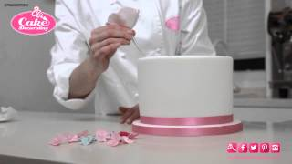 How to Stick Flowers/Ribbon onto a Cake - Cake Decorating Tutorial