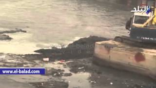 صدى البلد | الكراكات تزيل الطين والراوسب من النيل بعد انخفاض منسوب المياه