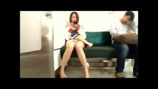 Asian girl with an ultra short skirt riding on a subway