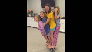 Four girls on a hoverboard