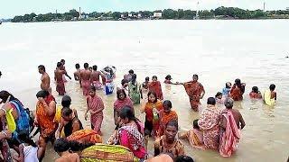 Snan at chaturthi before durga puja । men women girls children bathing at Ganges for big festival
