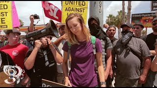 Sharia Law Protesters stand on corner with Leftist Protesters