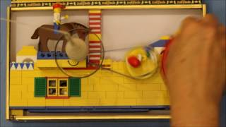 Spinning cotton on a Lego charkha