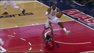 LeBron James jumps over Bradley Beal!