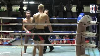 Tucker (Sinbi Muay Thai) from the U.S.A. fights at Patong Stadium and wins  by K.O. in Round 4