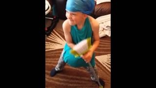 Boy dancing with broom