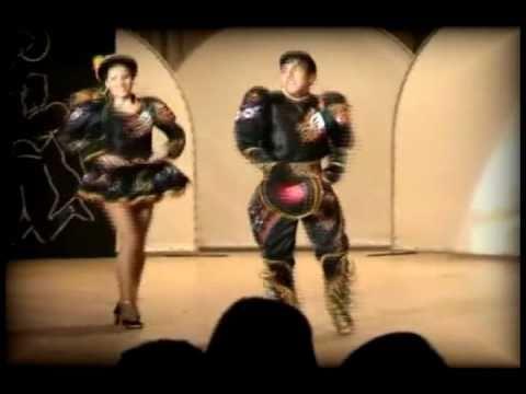 Sayas Baile Caliente kalamarka pareja de caporales
