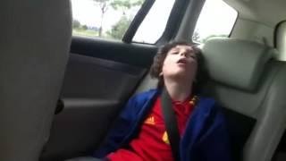 Boy sleeping in car