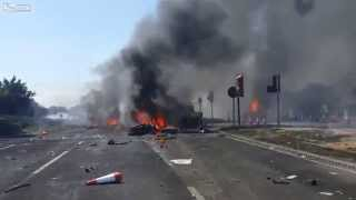 Aftermath of air show jet crash in England