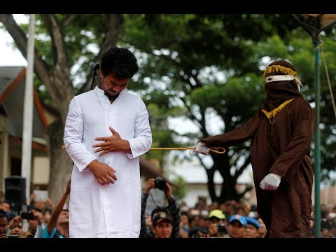 Xxx Mp4 Two Men Publicly Caned In Indonesia For Having Gay Sex 3gp Sex