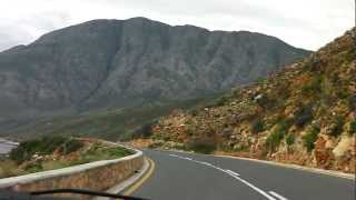 Driving on a scenic coastal road near Hermanus, South Africa
